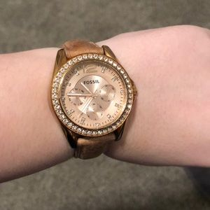 Tan leather and rose gold fossil watch